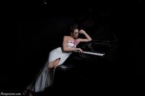 "'She plays piano in the dark"""