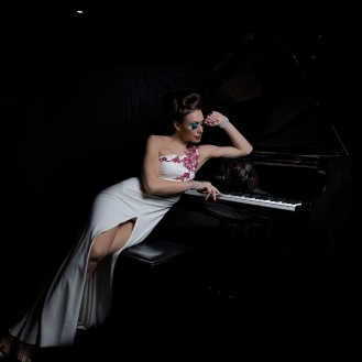 'She plays piano in the dark""